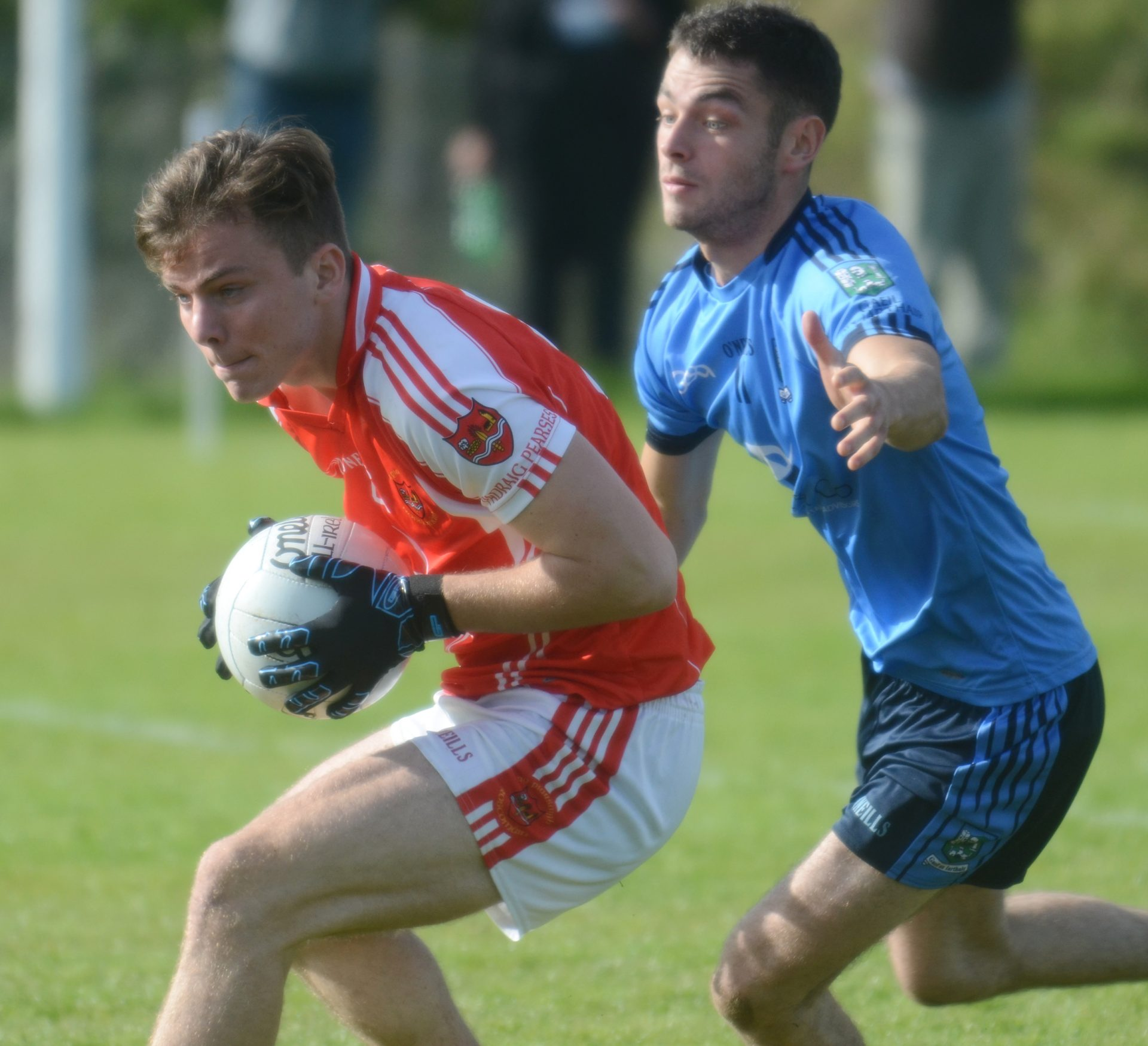 Mark Richardson shields possession from Niall Higgins during Sunday's semi-final at Elphin. Pic: Gerard O'Loughlin